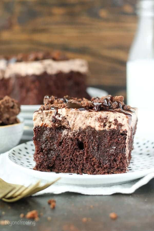 Sinful Brownie Batter Poke Cake. This chocolate poke cake is soaked with dark chocolate pudding, and topped a brownie batter mousse and brownie batter glaze. It's for true chocolate lovers.