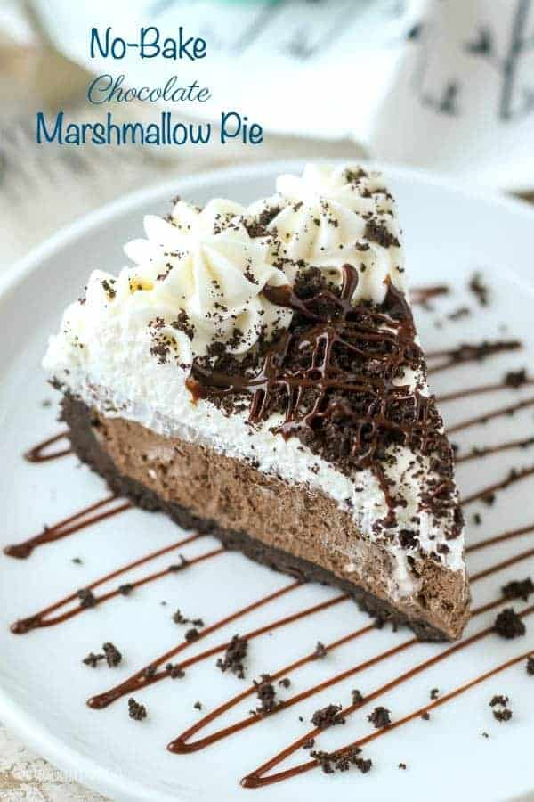 This No-Bake Chocolate Marshmallow Pie is heaven on earth!  The Oreo crust is filled with a fluffy chocolate marshmallow mousse and topped with whipped cream.