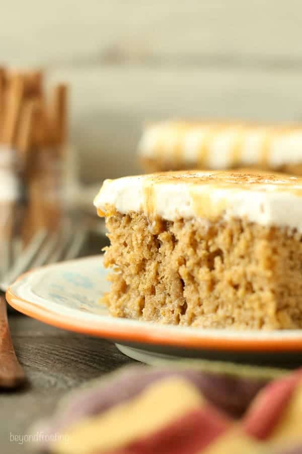 This Pumpkin Spice Latte Poke Cake is a simple pumpkin cake soaked in an espresso cream and topped with a cinnamon mocha whipped cream.