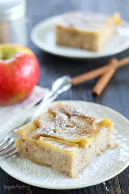 Satisfy your fall cravings with this Apple Upside Down Cake. This cake has a caramelized brown sugar topping with fresh sliced apples covered in a moist spice cake made with half the sugar of a normal cake.