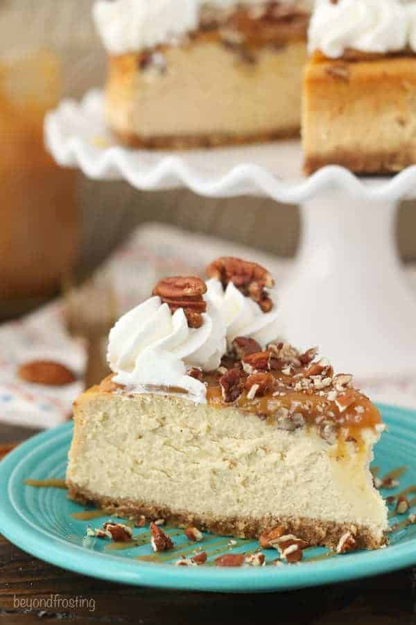 A rich caramel cheesecake with pecans and a homemade salted caramel sauce.