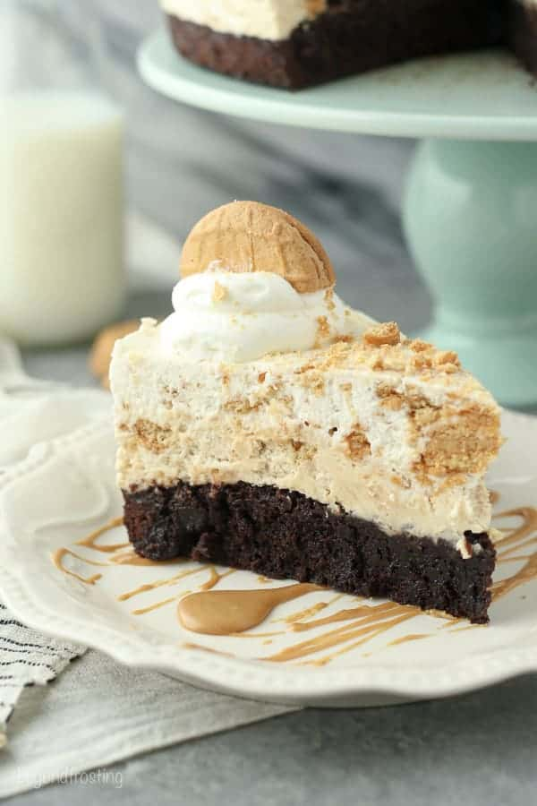 This Peanut Butter Brownie Mousse Pie is a fudgy brownie bottom with a peanut butter mousse and a Nutter Butter Cookie mousse on top.