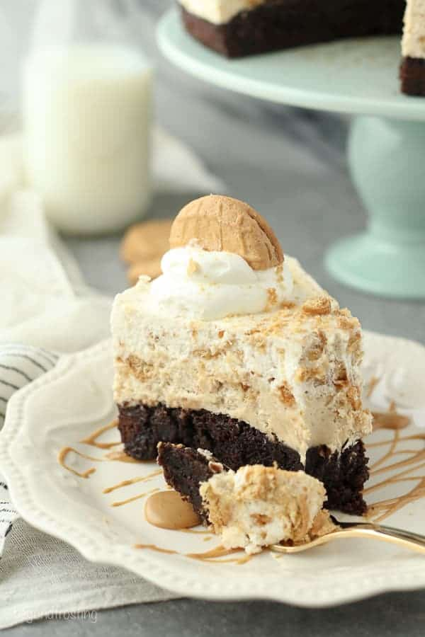 This is a Peanut Butter Brownie Mousse Pie has a fudgy brownie bottom with a layer of peanut butter cookie cheesecake and it's topped with a Nutter Butter Mousse.