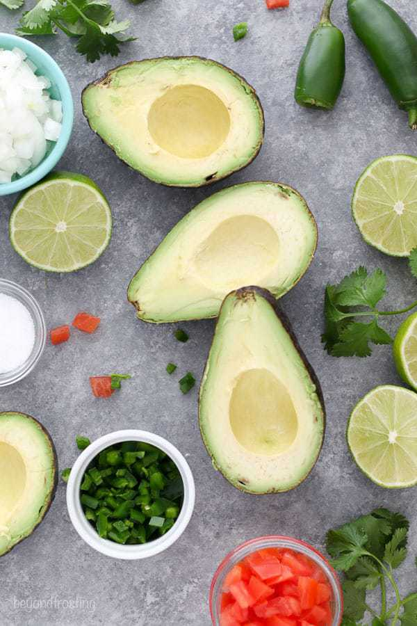 This Easy Guacamole Recipe is one you'll use over and over again. Avocado, lime, onion, salt, tomatoes and jalapeños made up this killer easy guacamole recipe.