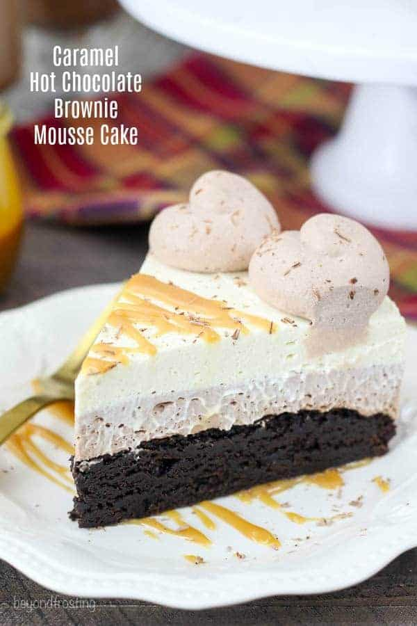 This decadent Caramel Hot Chocolate Brownie Mousse cake is three layers of dessert bliss. There is a layer of hot chocolate mousse and it's topped with a caramel whipped cream.