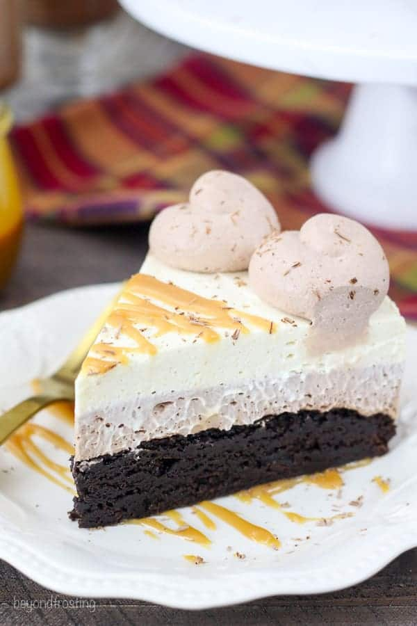 This decadent Caramel Hot Chocolate Mousse Cake is three layers and it starts with a fudgy brownie baked in a 9-inch spring form pan. The next layer is a hot chocolate mousse made with actual hot chocolate powder, cream cheese and whipped cream. The top layer is a caramel whipped cream made with brown sugar and caramel sauce.