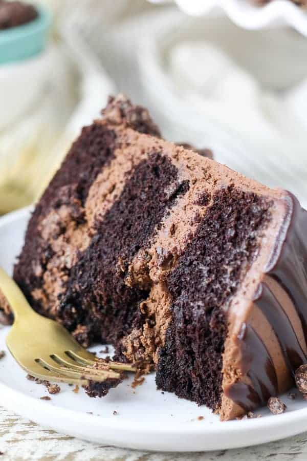 A mouthwatering slice of chocolate cake with a couple bites missing
