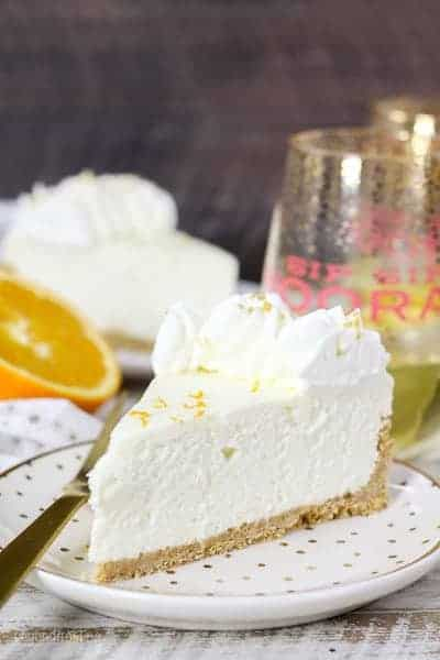 slice of no-bake mimosa cheesecake on a plate