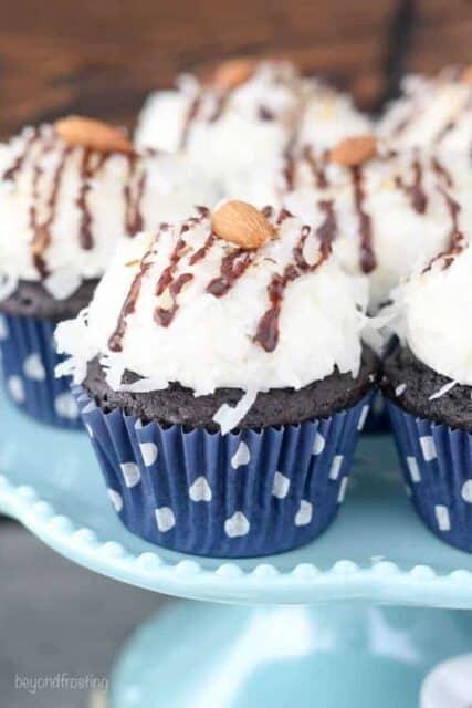 A few almond joy cupcakes on a cake plate