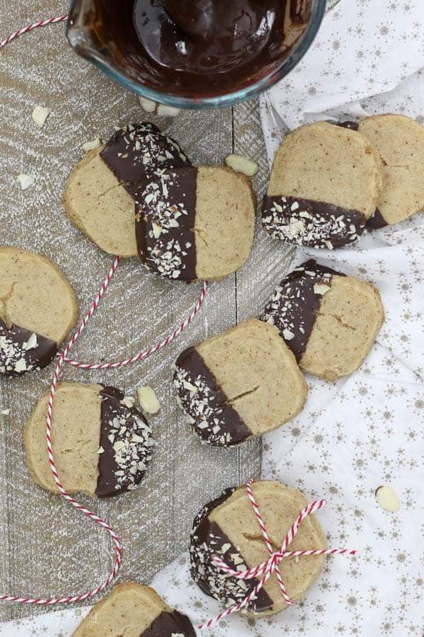a bunch of shortbread cookies on a piece of wood with a white napkin