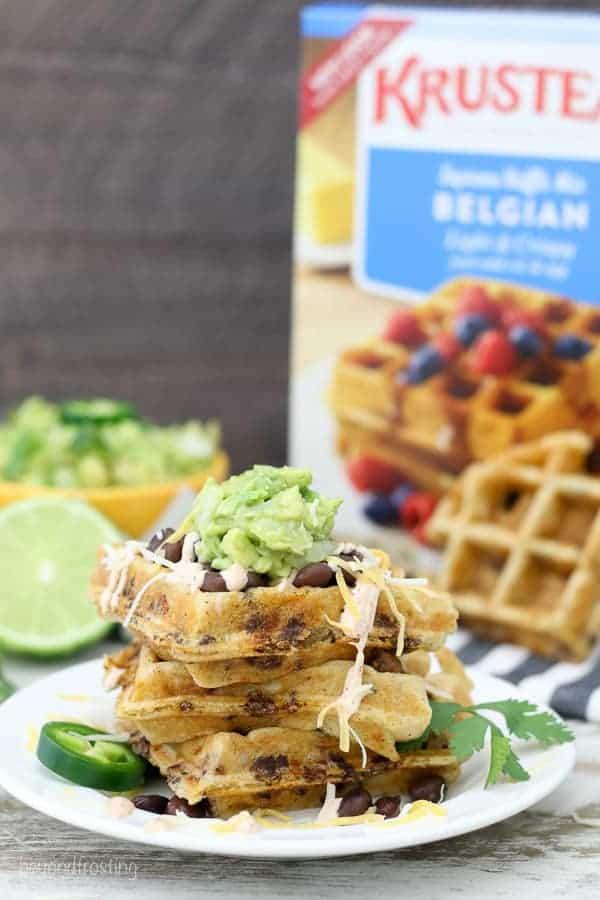 A plate of savory taco waffles with a box of Krusteaz Belgian Waffle Mix in the background