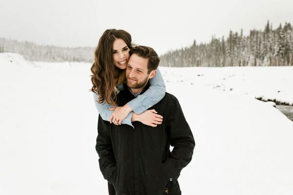 A engaged couple on a winter photoshoot