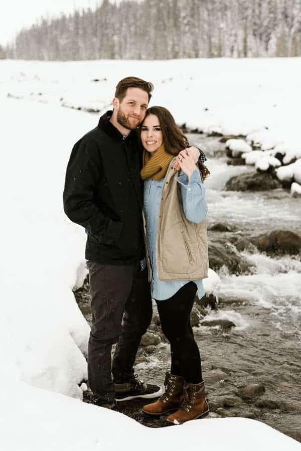 an engagement shoot in a snowy river scenery