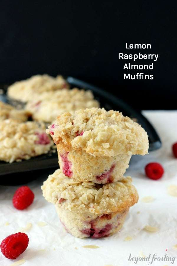 Two large bakery style muffins stuffed with raspberries and bursting with lemon flavor.