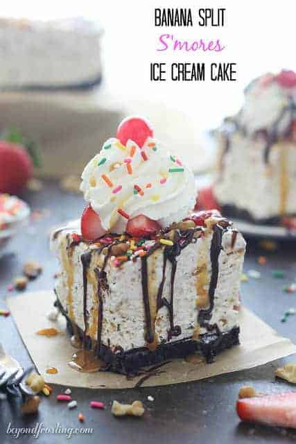 This Banana Split S'mores Ice Cream Cake is everything you've ever dreamed of in an ice cream cake. The airy no-churn s'mores ice cream is filled with marshmallow, chocolate and graham crackers plus smashed banana. Top this ice cream cake with your favorite banana split toppings and don't forget the sprinkles!