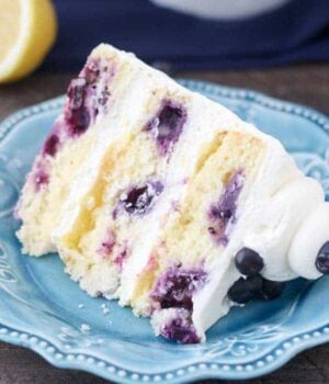 A Slice of Blueberry Lemon Mascarpone Cake on a Blue Plate