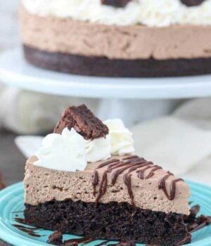 A slice of no-bake chocolate cheesecake with a brownie on the bottom.