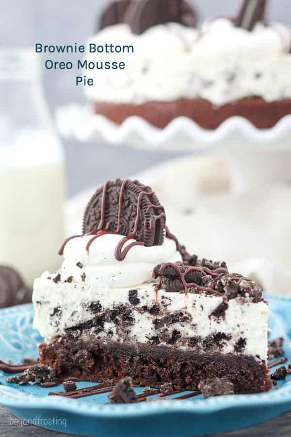 Oreo Mousse Pie with a layer of brownie on the bottom on a blue plate