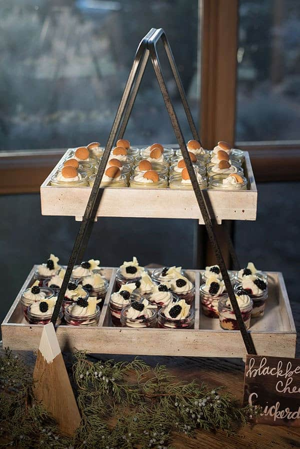 An old flower box is used to hold desserts on this rustic-themed dessert table