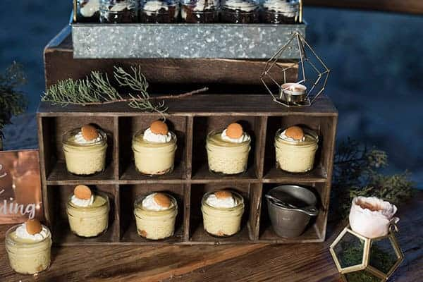 Rustic themed dessert table featured a vintage box filled with mini banana pudding cheesecake