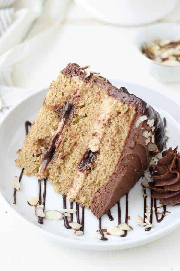 An overhead shot of a coffee flavored cake with ribbons of fudge and chocolate buttercream