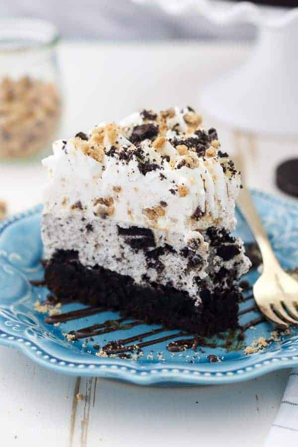 Image of a triple layer Oreo mousse cake with a brownie on the bottom.
