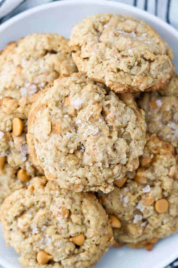 An overhead view of a gorgeous plate of butterscotch oatmeal cookies sprinkled with salted caramel