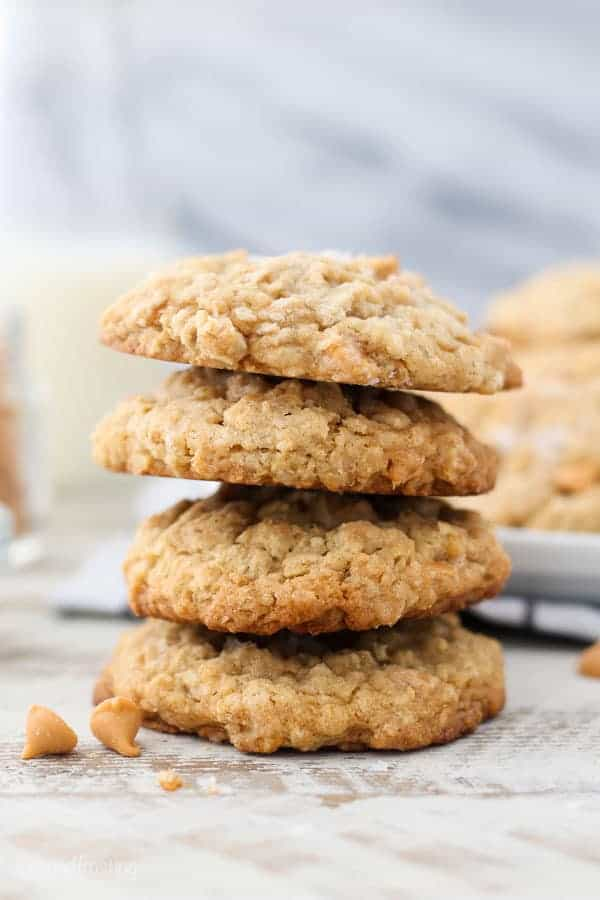 A tall stack of 4 oatmeal cookies garnished with butterscotch chips