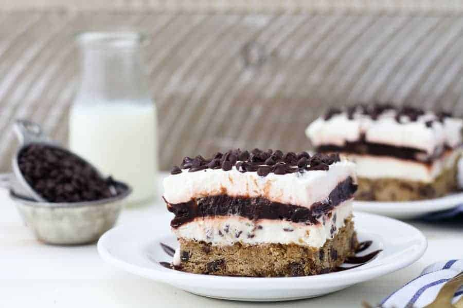 A wide angle shot of a slice of chocolate chip lasagna dessert