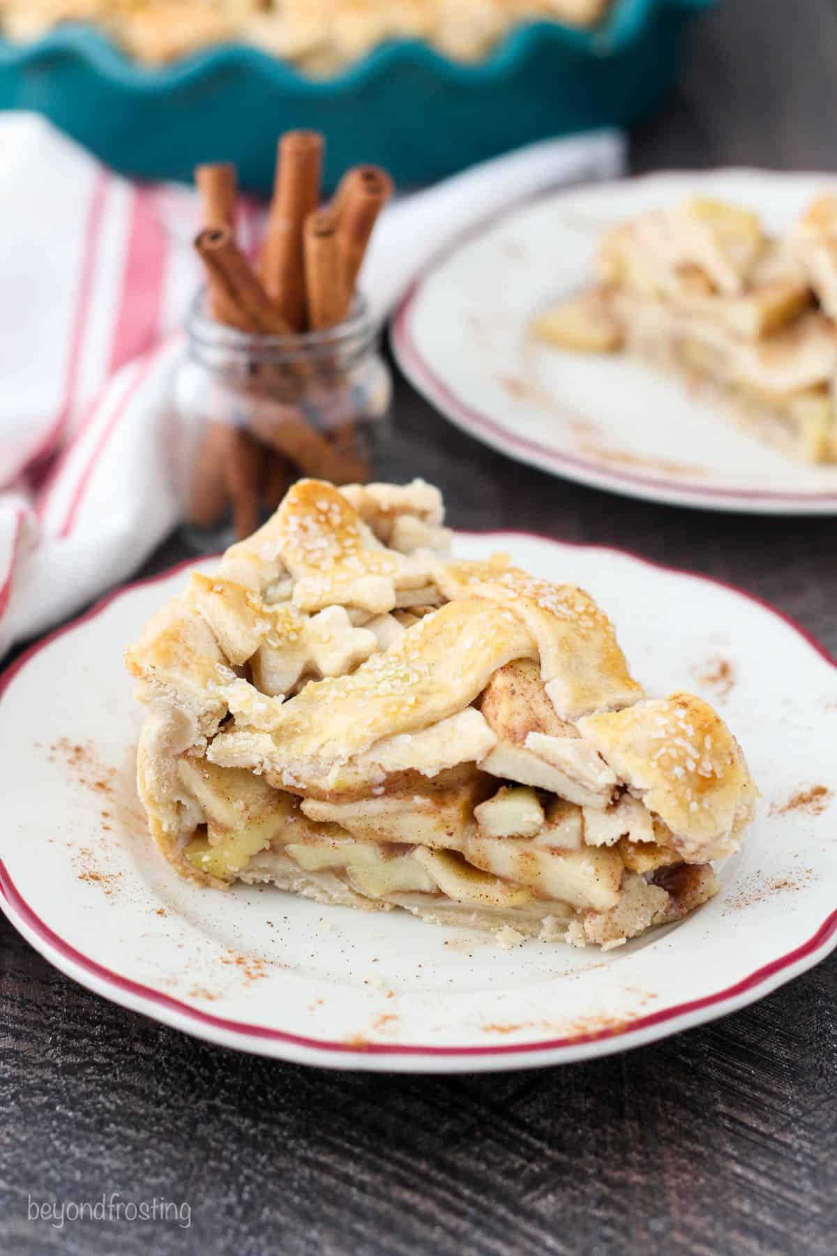 A perfect slice of layers of apple pie with a lattice crust