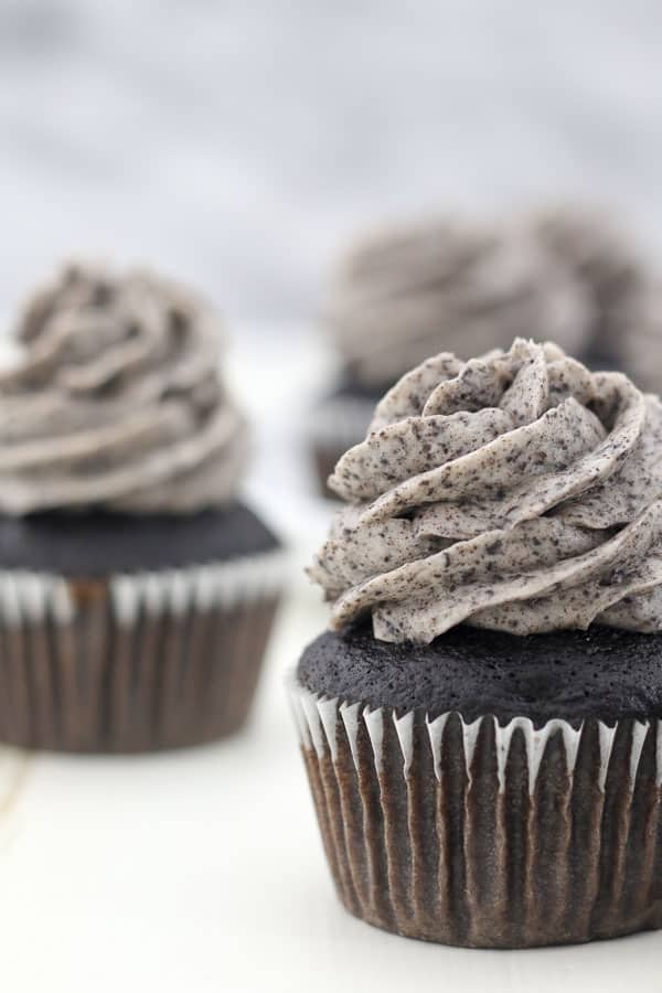 A close up shot of a chocolate cupcake frosted with the best Oreo frosting
