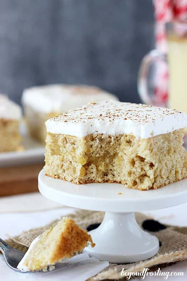 A close up of the inside of an eggnog poke cake with a couple bites missing