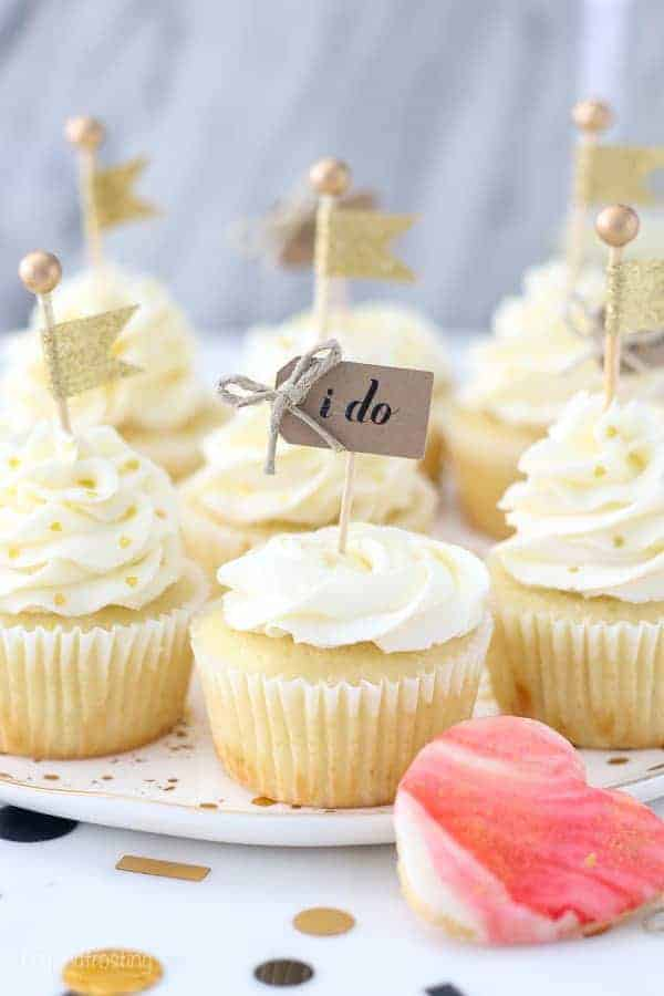 "These engagement themed cupcakes are super cute decorated with a buttercream rose and a little cupcake topper that says ""I do"""