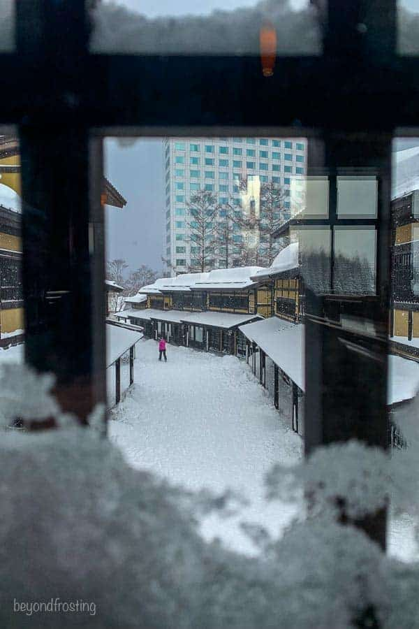 View out the window into Niseko Village restaurant and shops