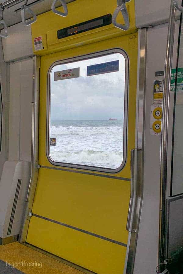 A view of the ocean out the window of the subway along the coast in Sapporo
