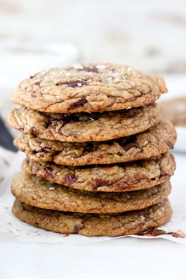 A stack of 6 chocolate chip cookies with crispy edges and melty chocolate