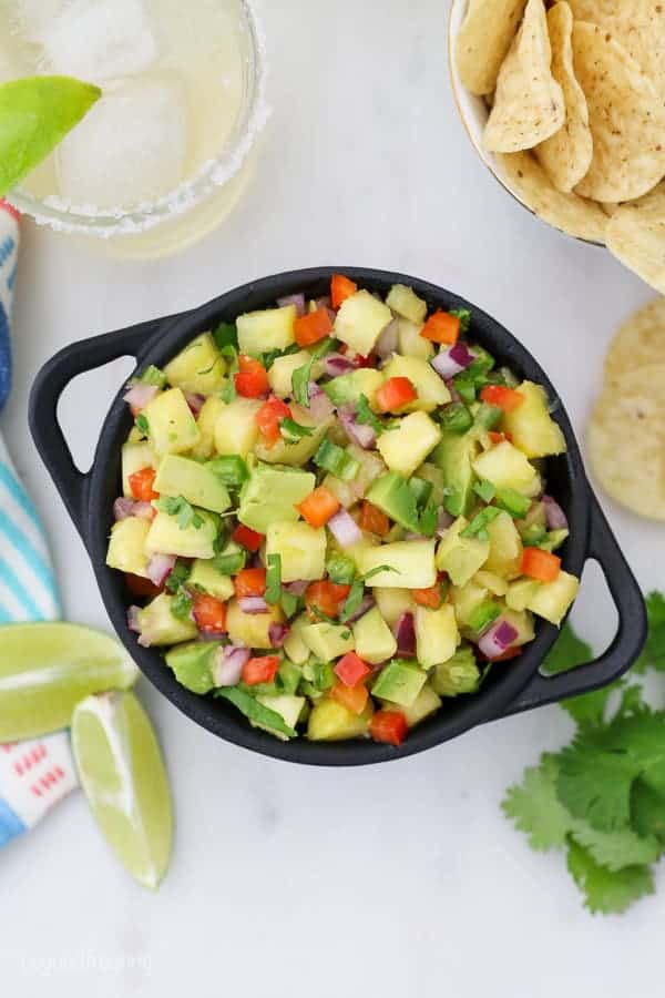 An overhead shot of pineapple salsa in a cast iron dish