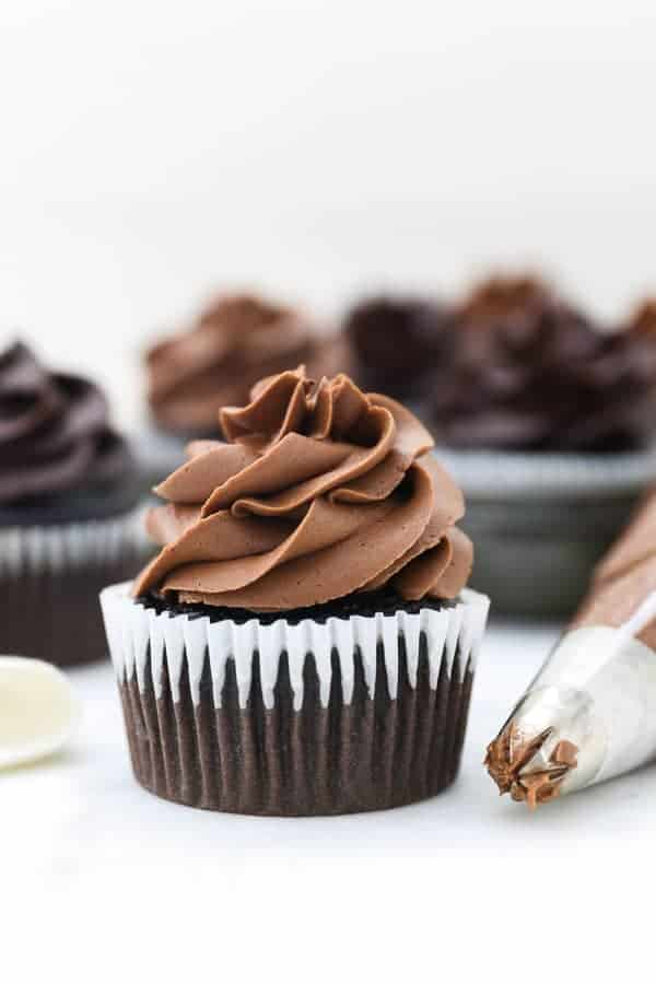 A gorgeous chocolate cupcake topped with a fluffy chocolate frosting