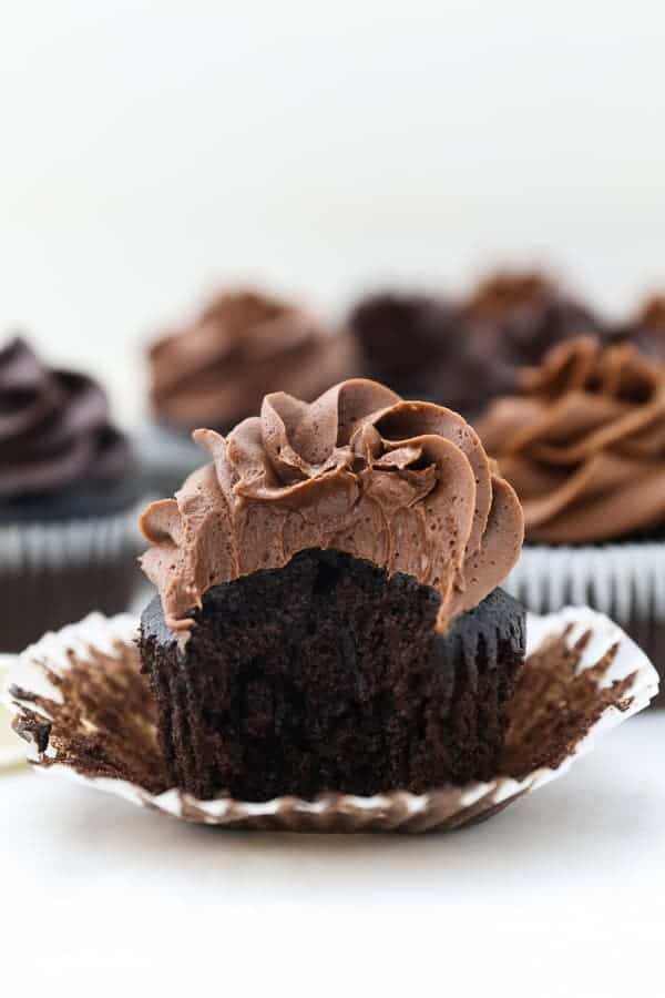 A fluffy chocolate cupcake topped with creamy chocolate frosting