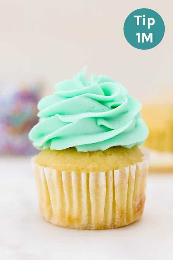 A cupcake frosted with a 1M piping tip, also known as an open star piping tip