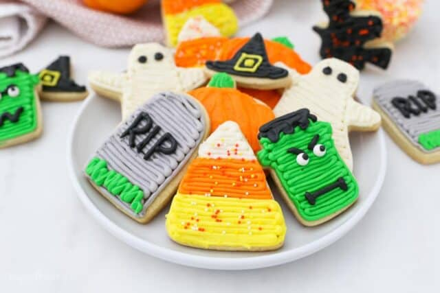 A plate of decorated halloween sugar cookies.