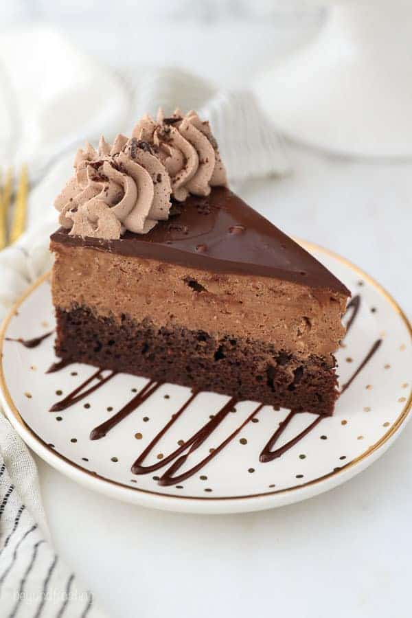 An overhead shot of a slice of chocolate cake showing the layer of ganache on top