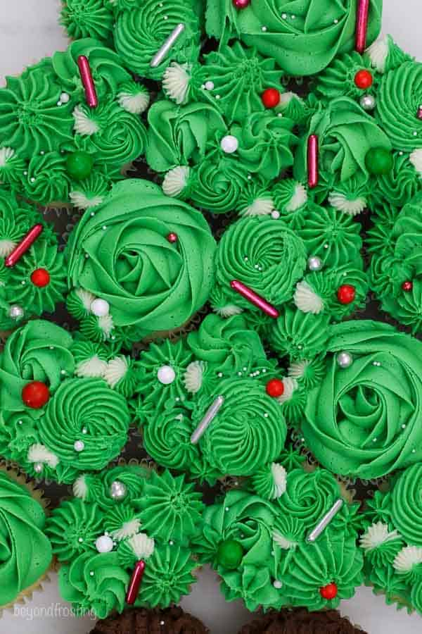 A close up shot of gorgeous green frosted cupcakes with Sweetapolita sprinkles