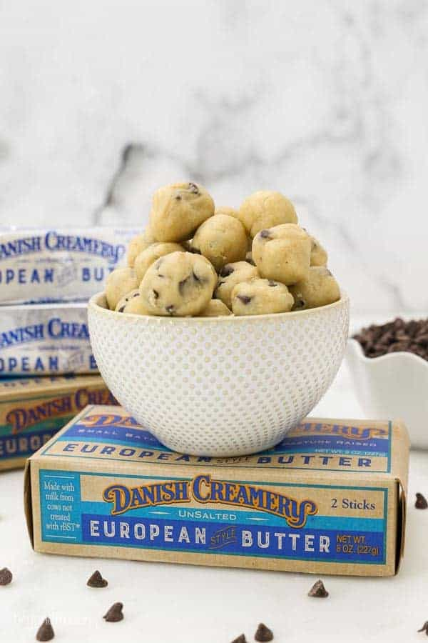 A small bowl of cookie dough balls sitting on top of a danish creamery butter