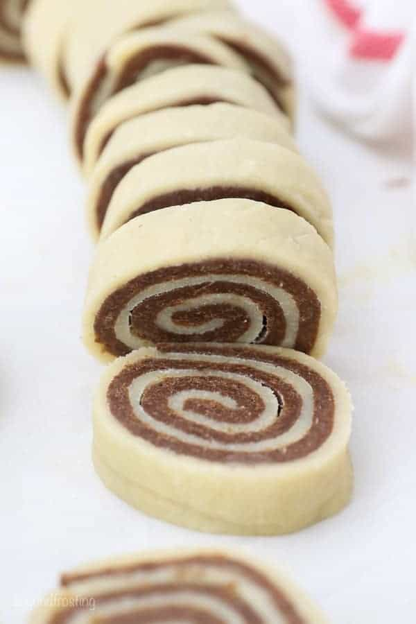 Pinwheel cookie dough, sliced and ready to bake