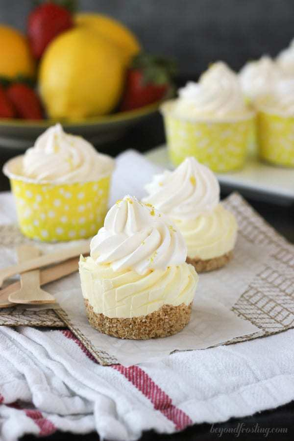 A mini frozen lemon pie without a wrapper showing the crust, the filling and the whipped topping