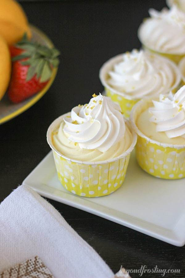 An overhead shot of no-bake lemon pies in cute little white and yellow polka dot liners