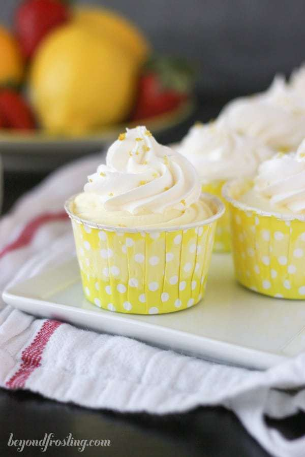 A pretty yellow polka dot cupcake liner filled with lemon mouse