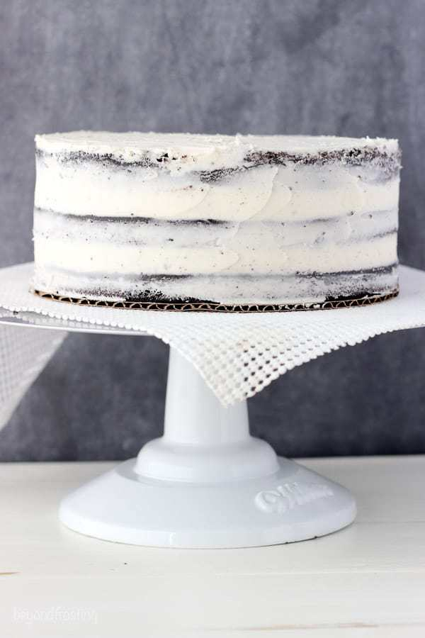 a layer cake frosted with a crumb coat