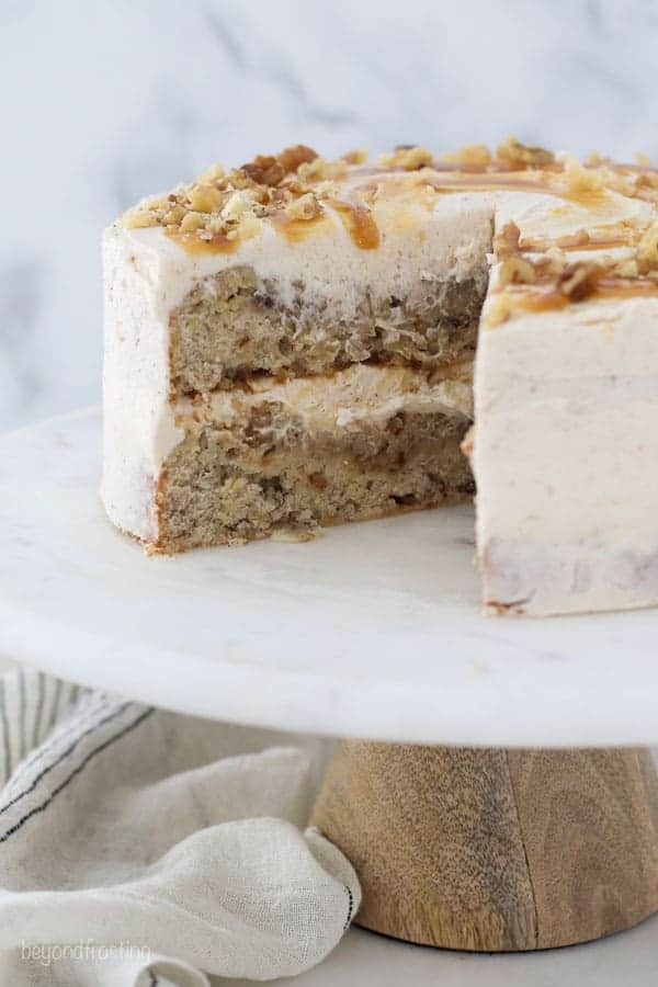 A two layer banana cake on a marble cake stand